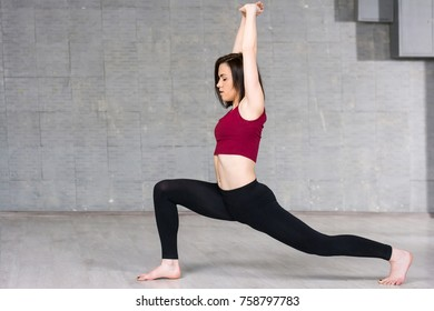 Young slim woman dancer in action. Young pretty woman in sportive clothing posing and pereforming contemporary dance i studio.