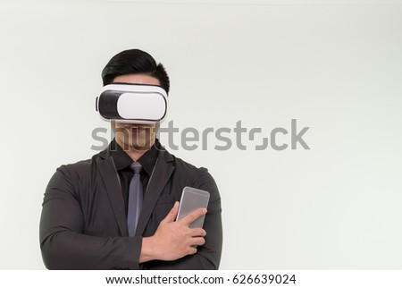 1279baad7eb6 Young sman in suit uses a virtual reality glasses on white background, Man  using a