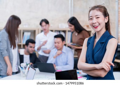 young smart asian entrepreneur startup company portrait smileing with successful and confident in brainstorm meeting office background