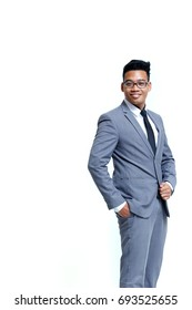 Young smart business man wear glasses posting in suit isolated on white with copy space