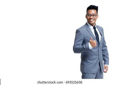 Young smart business man wear glasses posting thump up in suit isolated on white with copy space