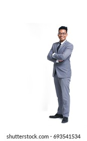 Young smart business man wear glasses posting folded arms and smile in suit isolated on white with copy space