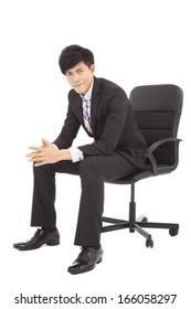Young smart businessman  sitting in a chair