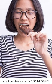 Young smile asian crazy girl enjoy eating chocolate vanilla ice-cream in summer hot weather have fun and good mood.