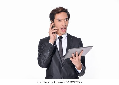 young smile businessman with mobile phone with use of digital tablet
