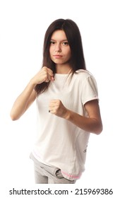 Young smile fitness woman showing fists isolated on white background