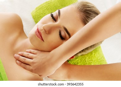 Young smile relaxed woman is massaged