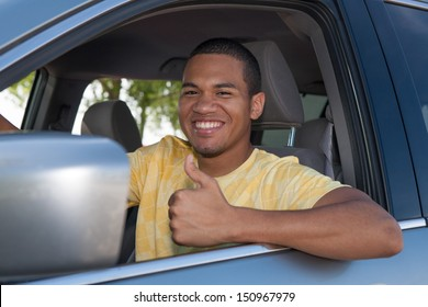 Young Smiling African American Male Thumb up in a Car