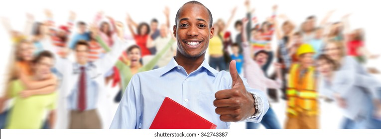 Young smiling African-american businessman over people group background.