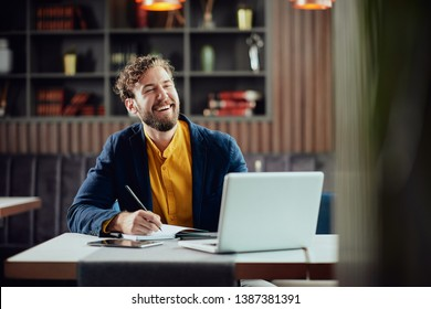 Young smiling bearded Caucasian blogger dressed smart casual wri