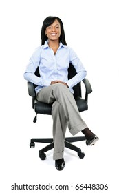 Young smiling black businesswoman sitting in leather office chair