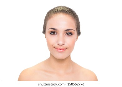 Young smiling brunette woman looking at camera on white background