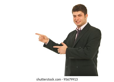 Young smiling business man indicate with both hands to copy space isolated on white background