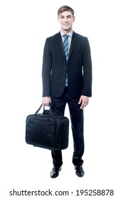 Young smiling businessman with a laptop bag in his hand