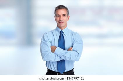 Young smiling businessman portrait.