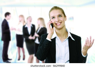 Young smiling businesswoman calling on phone