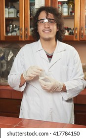 young smiling chemist with pouder mix in lab