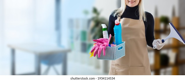 Young smiling cleaner woman in modern house
