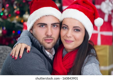 young smiling  couple  at Christmas night