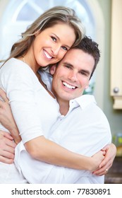 Young smiling couple at new modern home