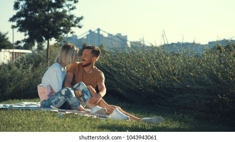 Young smiling couple in the park
