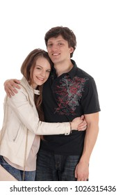 A young smiling couple standing and embracing each other, smiling,