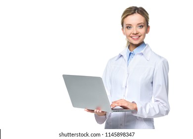 young smiling doctor in white coat holding laptop, isolated on white