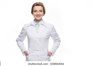 Young smiling female doctor standing isolated on white