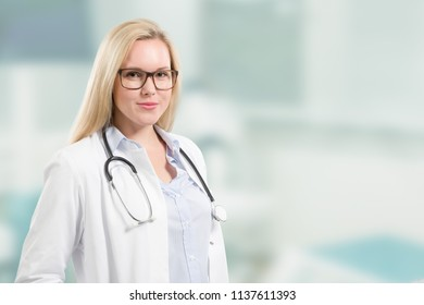 young smiling female doctor with stethoscope