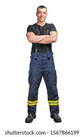 Young smiling firefighter with folded arms wearing black t-shirt and fireproof pants with suspenders. isolated on a white background