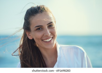 Young smiling girl at the beach