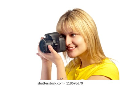 Young smiling girl with a camera