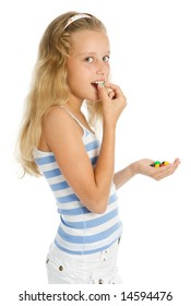 Young smiling girl with color chocolate candy