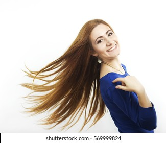 Young smiling girl with long healthy hair. Healthy strong hair. Strong hair.  Beautiful slim girl with a haircut. Hair style