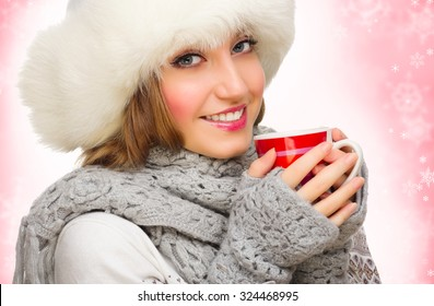Young smiling girl with mug on winter background