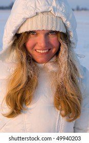 Young smiling girl in the rime