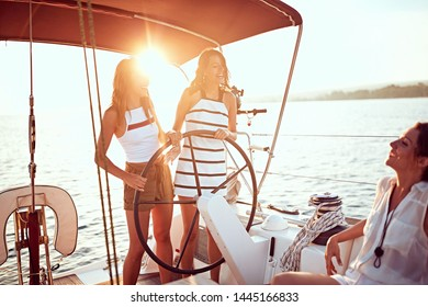 young smiling girl sailing on the luxury boat together and enjoy at sunset
