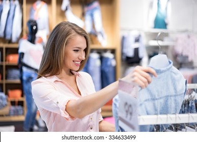 Young smiling girl in a shop