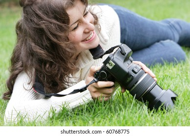 young smiling girl taking picture outdoors