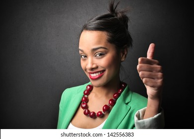 young smiling girl with thumb upwards