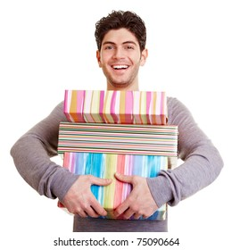 Young smiling happy man carrying christmas gifts