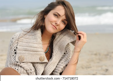 Young smiling happy woman portrait near sea beach, autumn fashion, healthy lifestyle concept