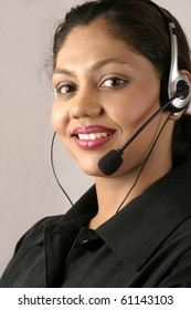 Young smiling Indian customer care assistant at call center