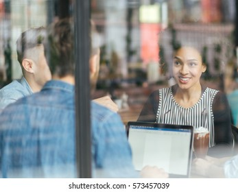 Young smiling people enjoying coffee.Double exposure .Small depth of field .