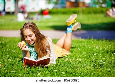 Young smiling student woman with book. University education.