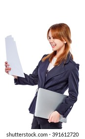 Young smiling and surprising business lady with laptop, looking at paper. Isolated on white background.