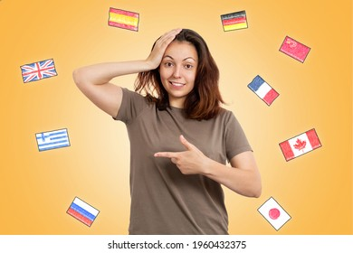 Young smiling thoughtful female student chooses a language to study, points her finger to the left. Yellow background with flags of different countries. The concept of learning foreign languages.
