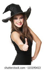 The  young smiling witch is thumb up