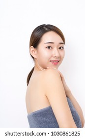 Young smiling woman with beautiful face, clean skin.