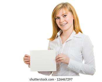 Young smiling woman with brackets and billboard isolated on white background